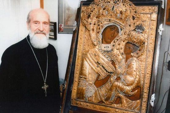 Archpriest Sergei Garklavs, of blessed memory, pictured here with the original Tikhvin icon.